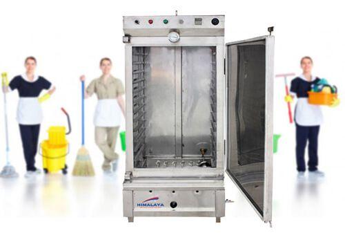vệ sinh tủ cơm công nghiệp dùng điện